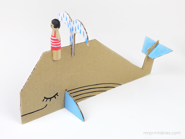 peg-doll-riding-cardboard-whale